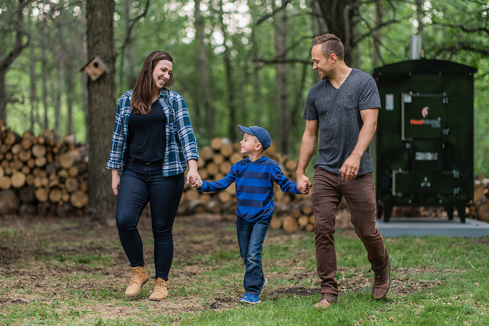 Family walking in front of their outdoor wood boiler