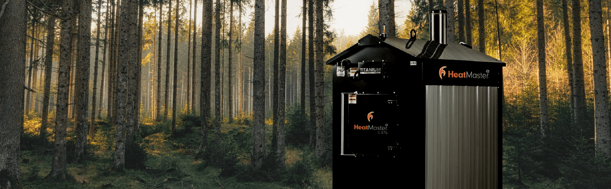 HeatMasterSS C375 coal furnace in woods